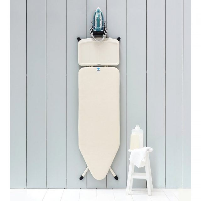 Combined iron and ironing board holder