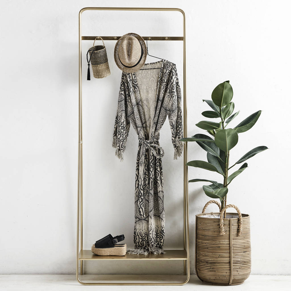 Brass coloured metal clothes stand with shelf