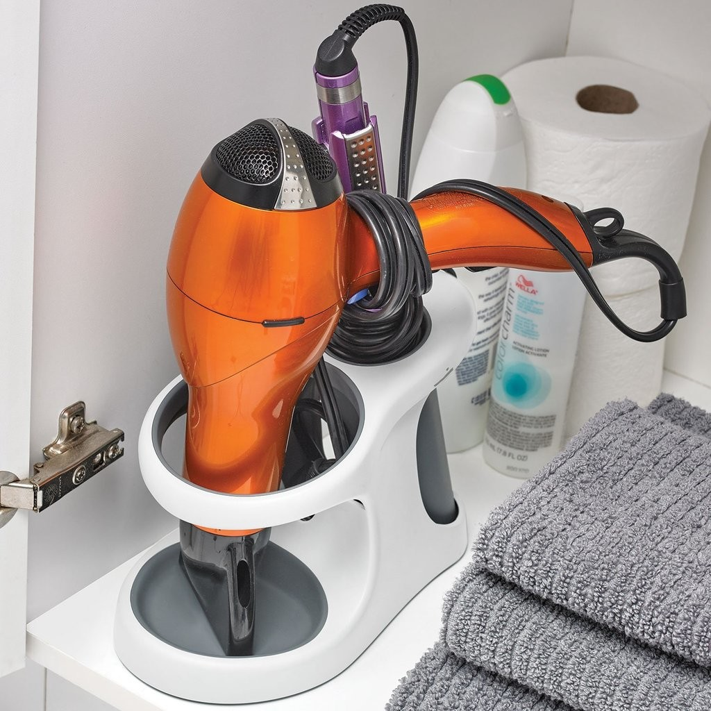 Combined hairdryer and straighteners holder