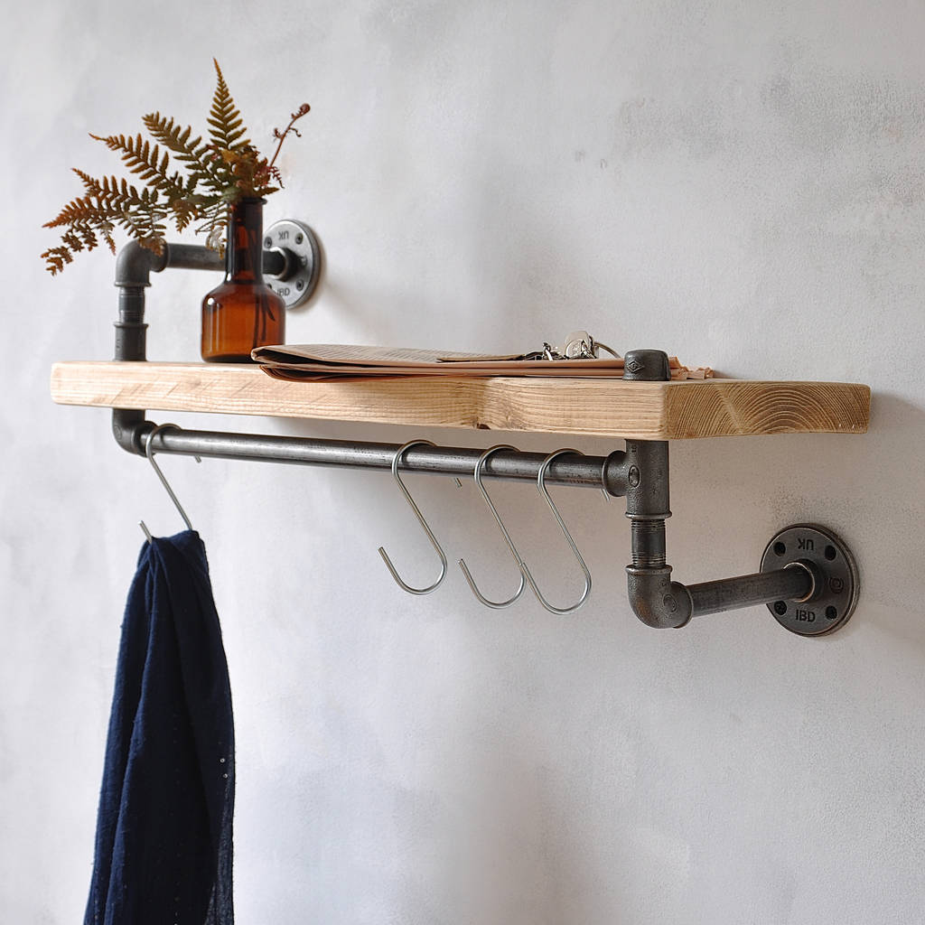 Wooden wall shelf with industrial pipe hanging rail