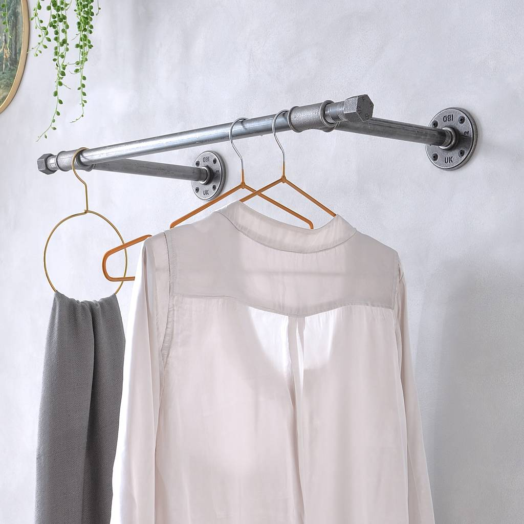 Wall mounted clothes rail made from industrial pipes