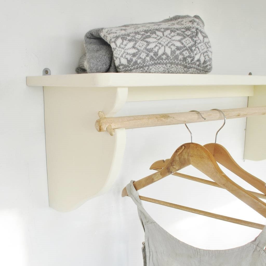 White wall mounted shelf with single clothes rail