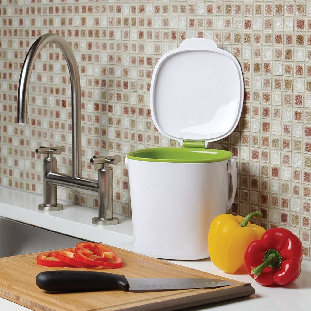 White food bin with green liner