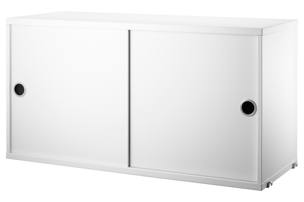 White modular cupboard unit with sliding doors