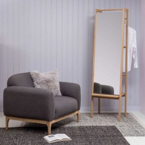 Tall mirror on wooden frame with clothes rail