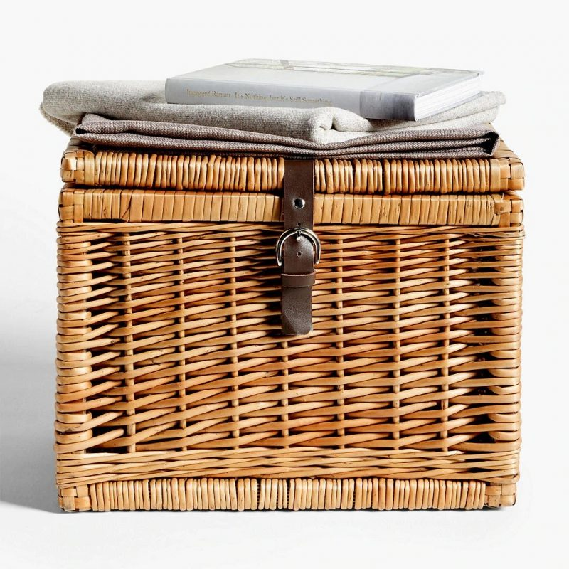 Small wicker trunk with leather strap