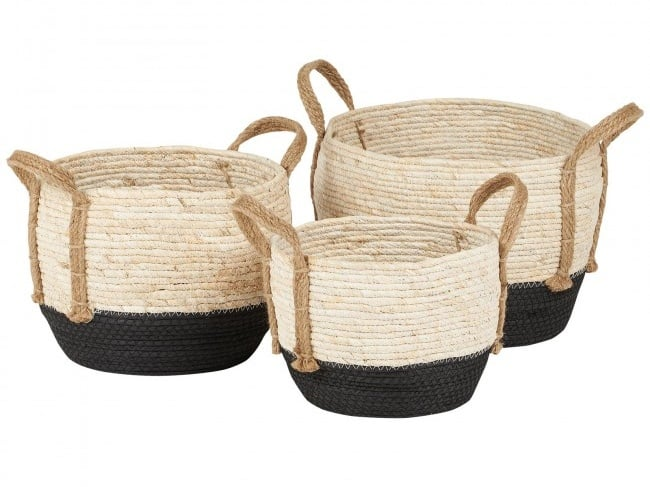 Natural storage baskets with black bottoms