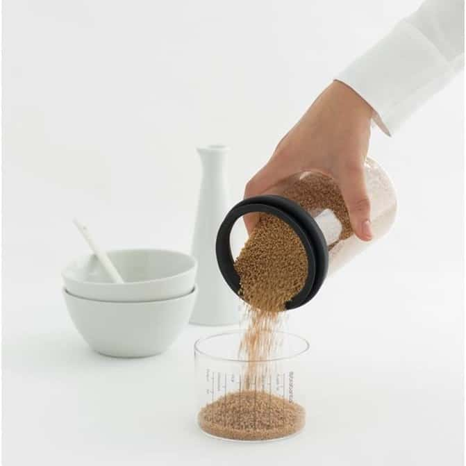 Food storage container with a measuring cup