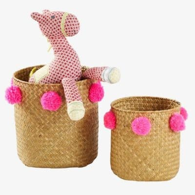 Woven baskets with pom-poms