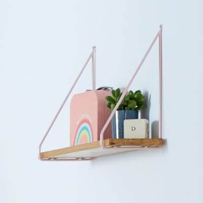 Wooden shelf with pink metal brackets