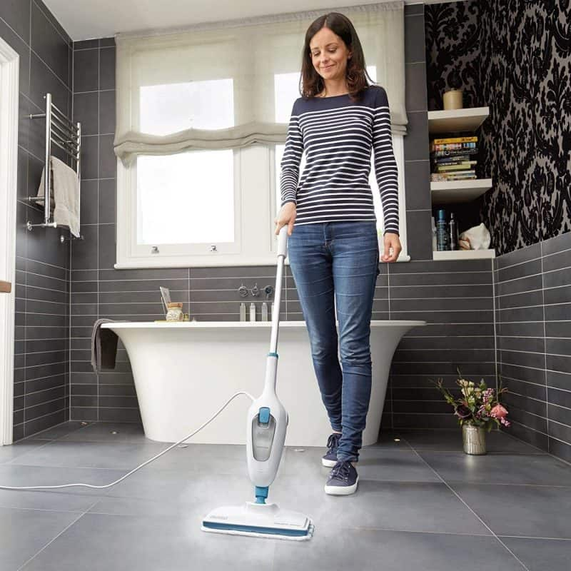 Cleaning the bathroom floor with a steam mop