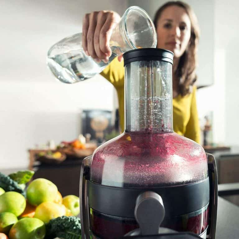 Lady using a juicer