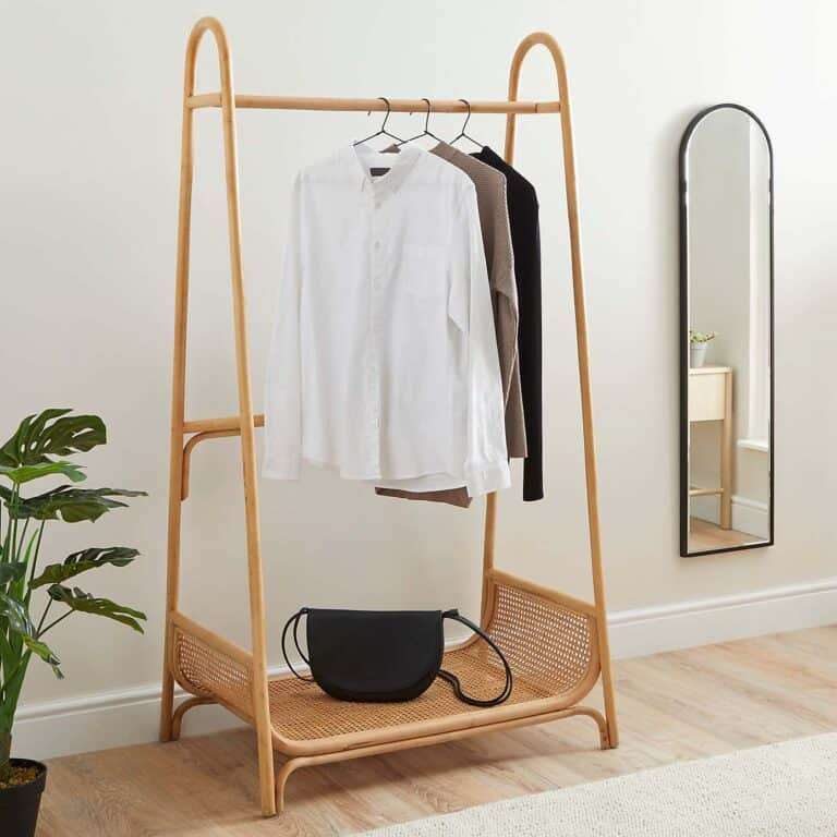 Cane clothes rail with curved shelf